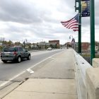Traffic passes on the Bridge Street bridge over the Grand River in downtown Grand Ledge.