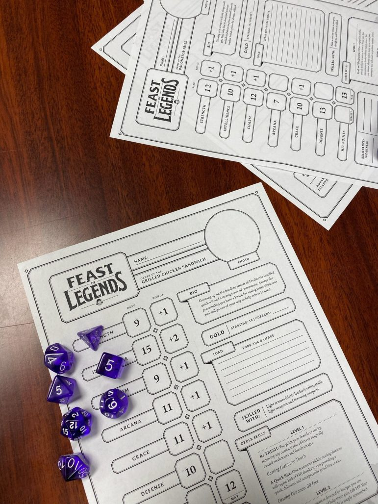 Participants in the Oct. 25 game night played Feast of Legends. The Holt-Delhi Library provides interactive game nights among residents.