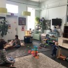 Mothers Renee Sommerlot and Stacie Lauterbach play with their children at Mother and Earth Baby Boutique.