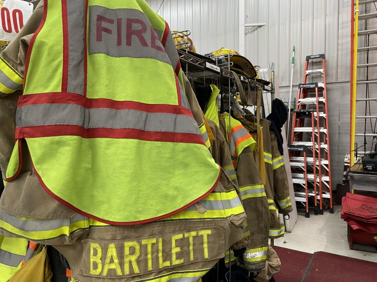 """Fire coat that says """"Bartlett"""" on the back."""