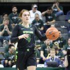 Michigan State guard Taryn McCutcheon surveys the court as she dribbles