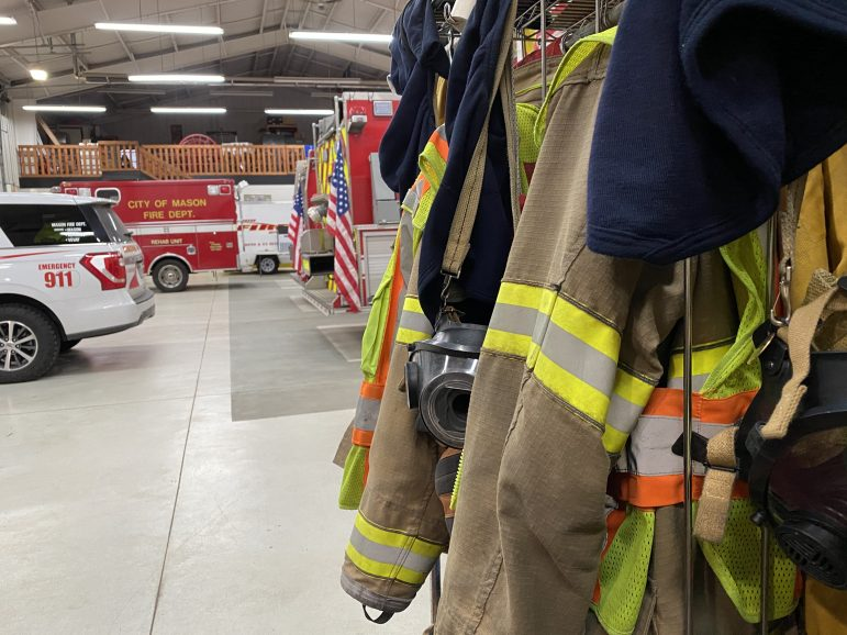 Firefighters' coats, masks and hoods.