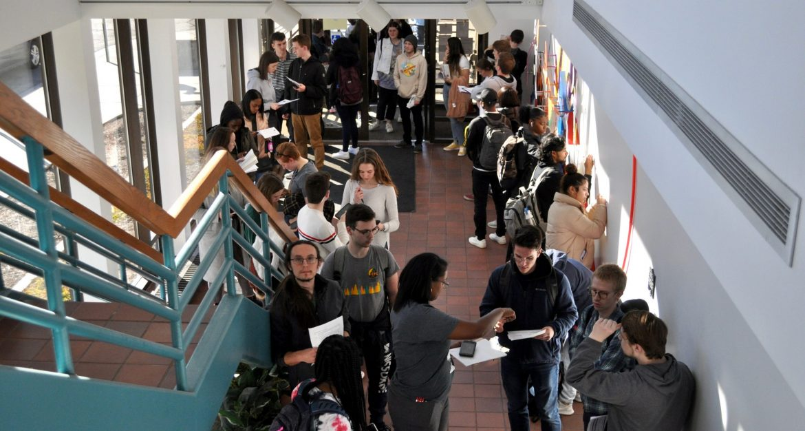 Line of students inside hallway