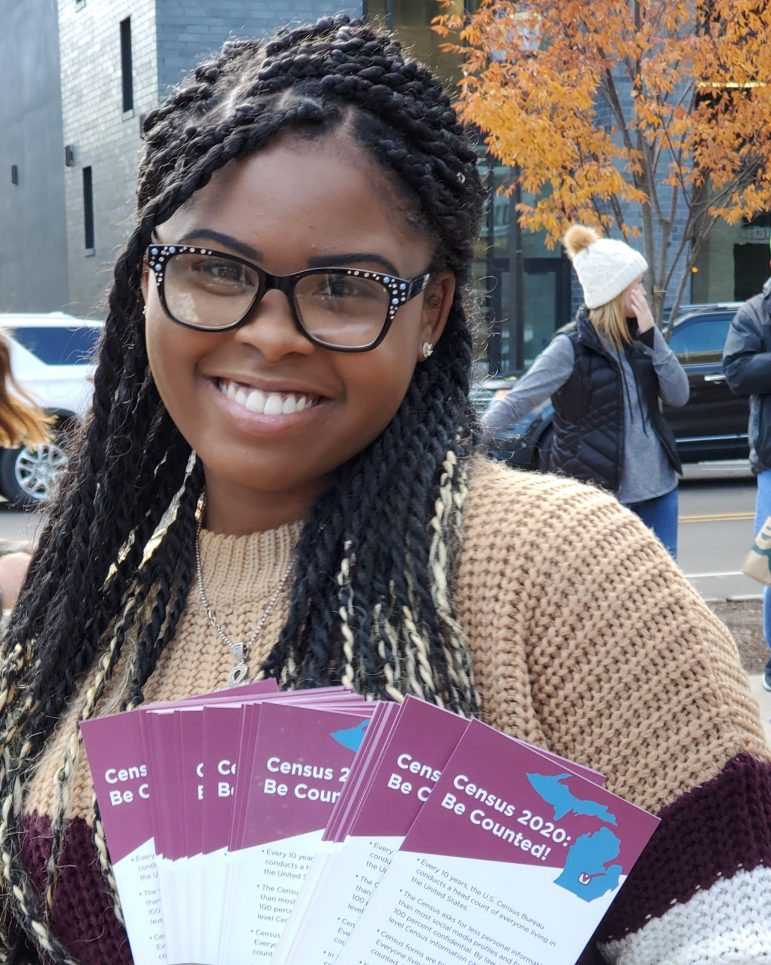 Woman holds Census flyers