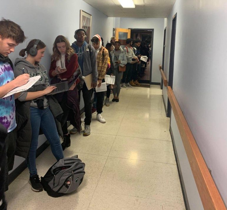 MSU Students lined up at the City Clerk's Office working on homework