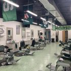 Empty barbershop with about a dozen chairs