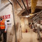 Rob Blackshaw, director of operations for the Michigan State Capitol Commission, walks through the Capitol's former basement boiler room, which now contains equipment for the building's new geothermal heating and cooling system.