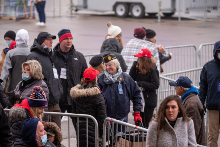 Supporters of President Donald Trump await his arrival at the Capital Region International Airport for a political rally on Tuesday, Oct. 27.