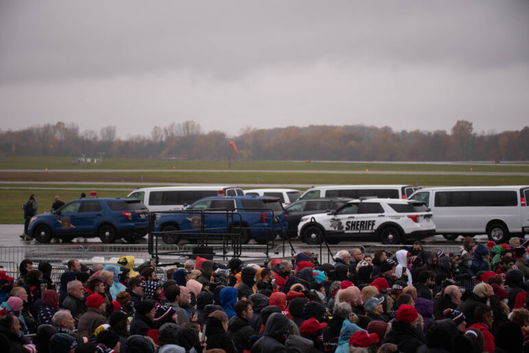 Police from across the region stage to provide security for President Donald Trump's rally at the Capital Region International Airport in Lansing on Tuesday, Oct. 27.