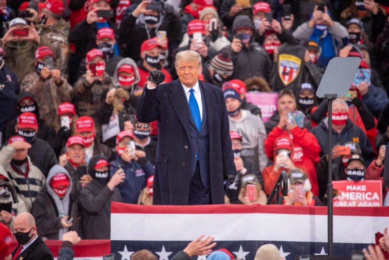 President Donald Trump greets supporters at a campaign rally at the Capital Region International Airport on Tuesday, Oct. 27, in Lansing.