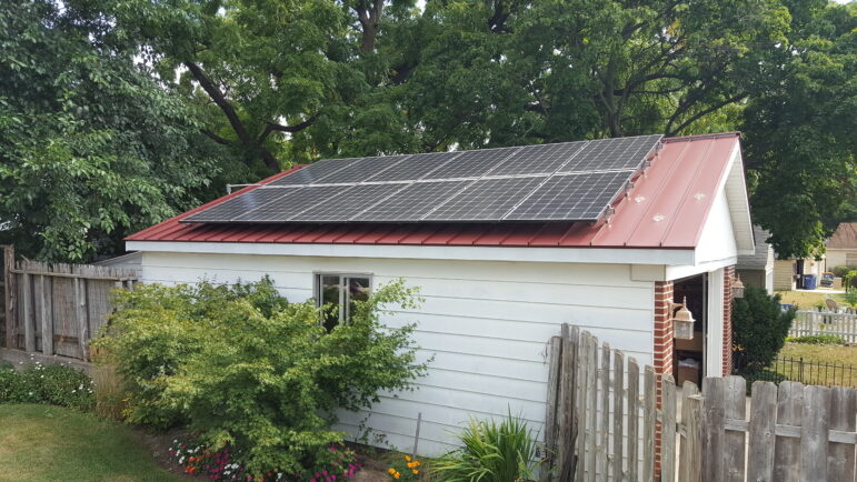 The first solar panels Bob Synk had installed in 2018 on the roof of his garage in Grand Rapids.