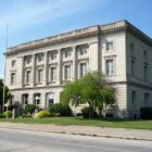 The Federal Building in Sault Ste. Marie is part of the Soo Commercial District recognized on the National Register of Historic Places. The building was constructed in 1910 as a post office and site of federal government operations. It is now the Soo's City Hall.