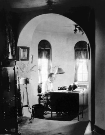 Author James Oliver Curwood sits in his writing studio in one of Curwood Castle's turrets.