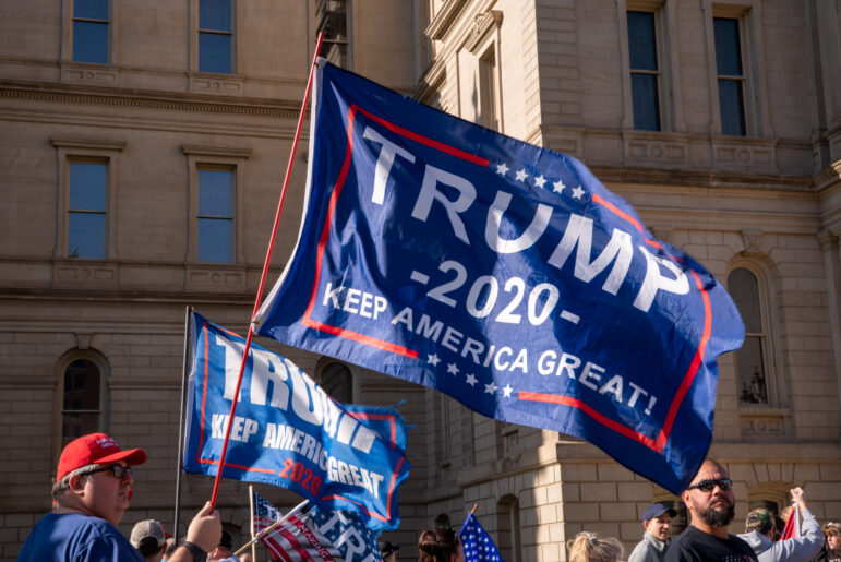 Trump 2020 flags wave at the Michigan Capitol during a rally on Nov. 14 protesting the election of Joe Biden as president.