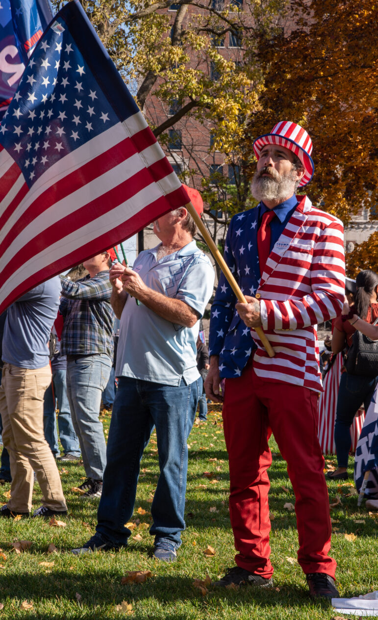 A man dressed in an American flag suit waives a flag during a rally at the state Capitol on Nov. 14 protesting alleged fraud in the 2020 presidential election.