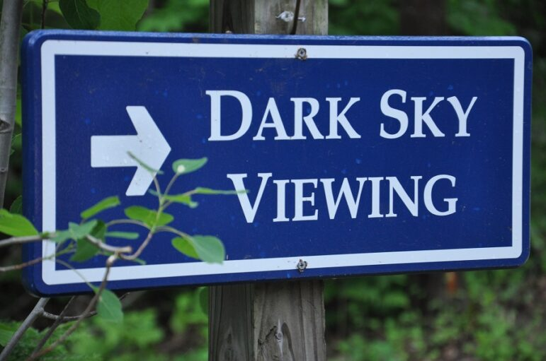 A Headlands sign directs visitors to the park's dark sky viewing spots