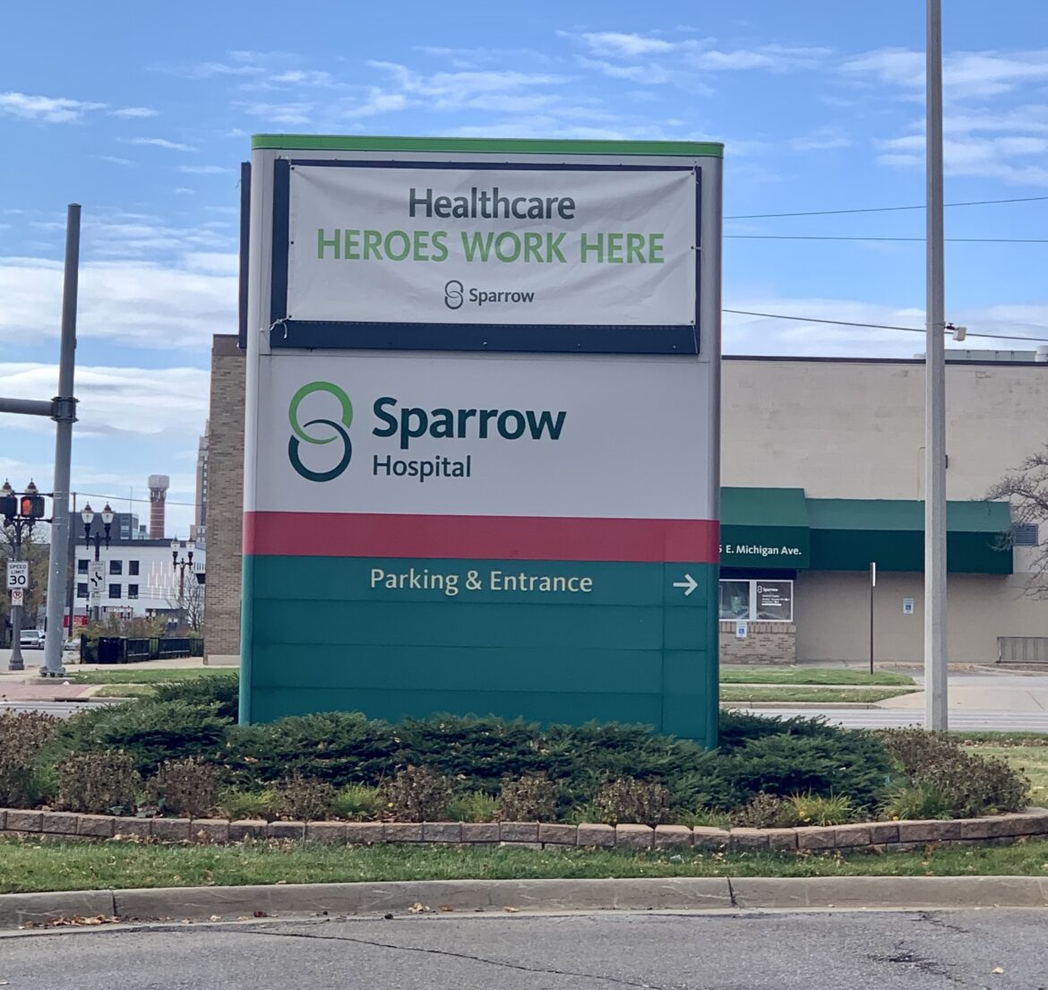 A sign outside Sparrow Hospital thanks health care workers.