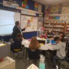 Brian Walmsley reads to a third grade class at Will L. Lee Elementary School.