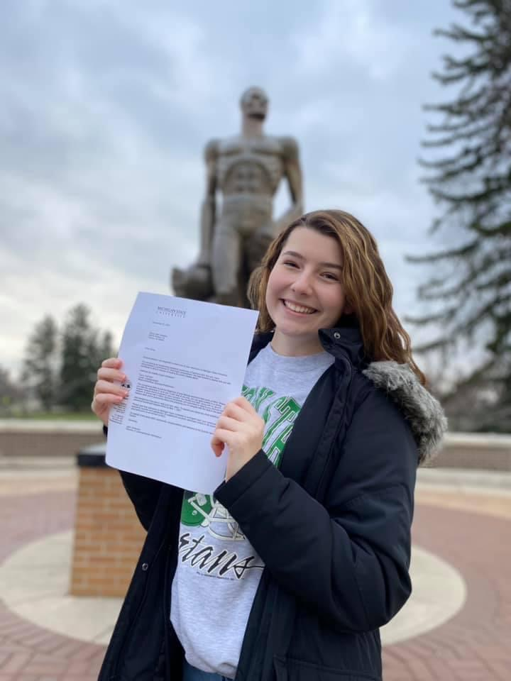 Olivia Nasiatka, senior at Cousino High School, holding her Michigan State University acceptance letter.