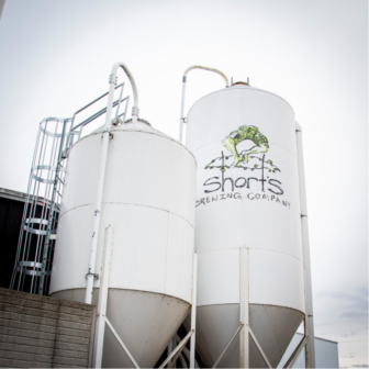 Silos at Short's Brewing Co. hold spent grain for local farms to pick up.