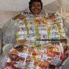 Eradajere Oleita displays a sleeping bag made of snack chip bags.