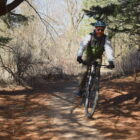 David Ludeke ride his mountain bike on a trail at Luton Park in Rockford.