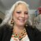 Tribal Elder Randi McKinney wears traditional Native American jewelry at her home.
