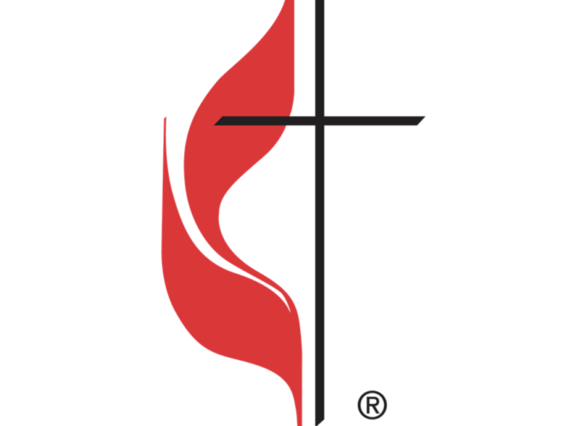 Methodist church logo shows cross and red flame