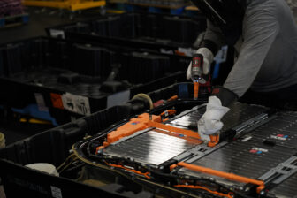 Electric vehicle battery disassembly in action.