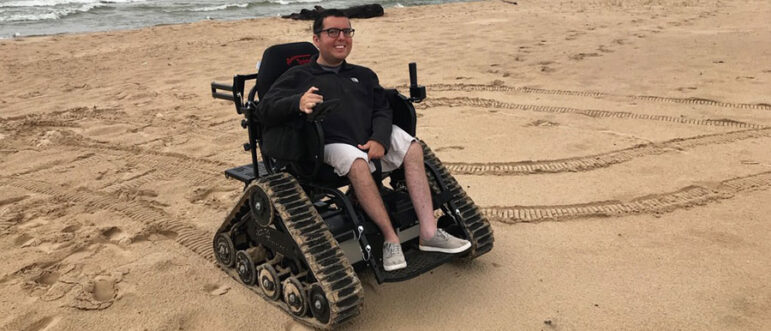 A visitor uses a track chair to access the beach. Unimproved areas are otherwise inaccessible to those in wheelchairs
