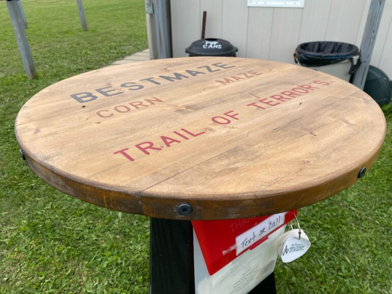A custom table outside of the corn maze. Best Maze and the Trail of Terrors are featured attractions.
