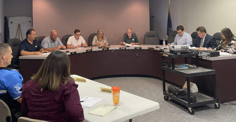 (L-R) City Treasurer Rachel Piner, Police Chief Jim Wolf, Councilmember Daniel Rhines, Councilmember Tommy Pratt, Councilmember Brandon Lanyon, Mayor Tammy Gilroy, Mayor Pro-Tem Noah Belanger, two empty seats for the absent Councilmember Terry Hansen and the Councilmember vacancy, City Manager Corey Schmidt, City Attorney Timothy Perrone and City Clerk Holly Thompson. Williamston City Council returns for a meeting for the first time in a month after the cancellation of the Sept. 13 meeting. This cancellation left the council with a lengthy action items list to review